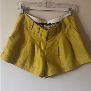 Chartreuse mid-rise pleated shorts